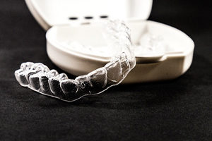 Clear aligner by travel case.