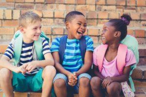 Children smiling at school after visiting West Brookfield dentist