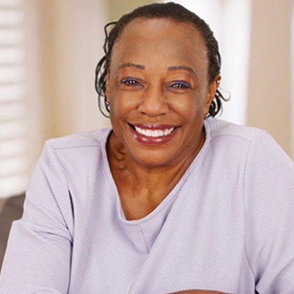 Smiling woman with dental implants in West Brookfield