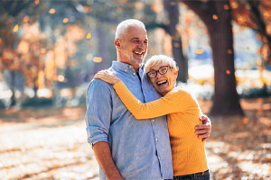 Laughing couple with dental implants in West Brookfield