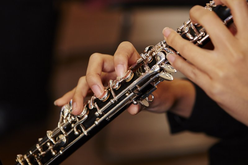 Closeup of person playing a saxophone